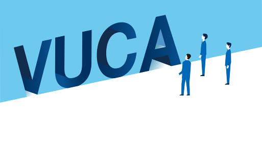VUCA、ブカの壁を見つめるビジネスパーソン、コンセプトイメージ、ベクターイラストレーション