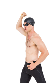 Swimmer posing after victory