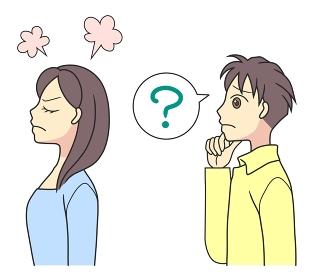 背中を向けて怒る若い女性と、理由が分からず困る若い男性