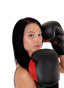 Close up of woman with black boxing cloves
