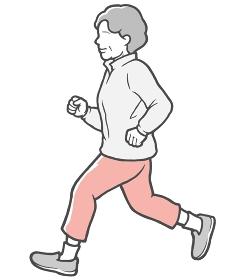 パーカーを着てジョギングする横向きの中年女性