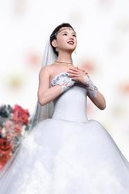 結婚式を挙げる純白のウエディングドレスを着た花嫁が胸に手を当て空を見上げる