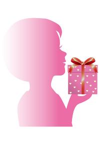 プレゼントを持った女の子のシルエット
