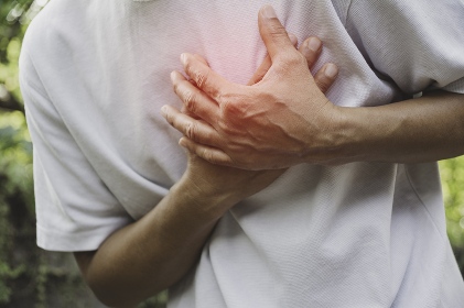 Man suffering from chest pain. Acute pain in a man muscle concept with red spot.