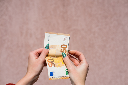 Hand couting holding and showing euro money or giving money. World money concept, 50 EURO banknotes EUR currency isolated with copy space. Concept of rich business people, saving or spending