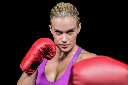 Portrait of female boxer with fighting stance