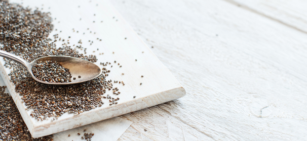 Chia seeds with a wooden spoon