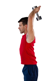Side view of sportsman exercising with dumbbells
