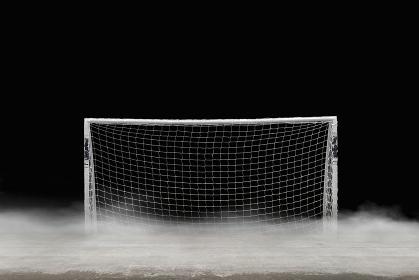 背景素材 / サッカーのゴールと砂嵐の舞うグラウンド イラスト
