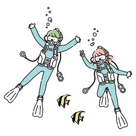 スキューバーダイビングを楽しむ男女