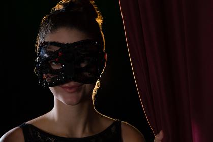 Woman wearing masquerade mask