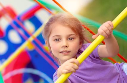 Little girl on playgarden