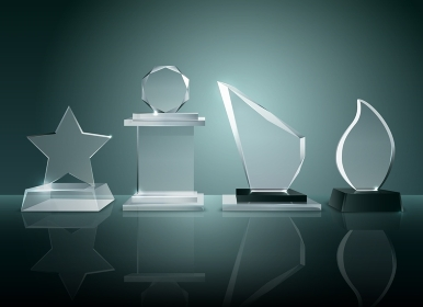 Glass Trophies Background Reflection Realistic Image . Sport competitions glass trophies prizes collection on transparent reflective surface realistic image with dark shadowy background vector illustration