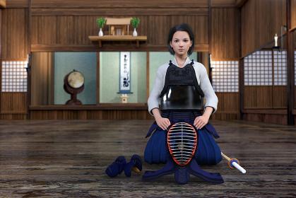 神棚がある剣道場で真剣な顔をして防具を身につけ正座をする女の子