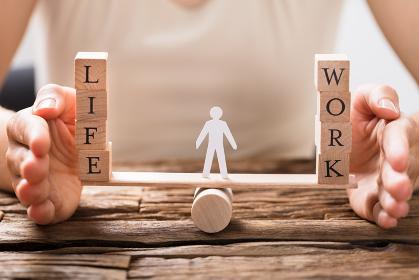 Human Hand Protecting Balance Between Life And Work