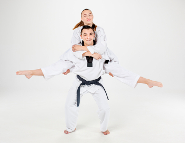 The karate girl and boy with black belts