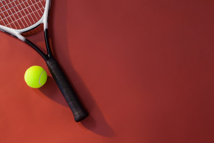 Overhead view of tennis racket and ball