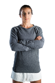 Portrait of female coach with arms crossed