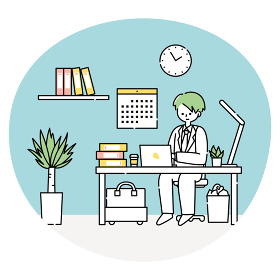 オフィスでパソコンに向かって仕事をする男性
