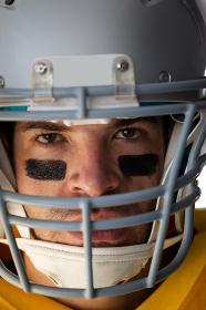Close-up of American football player wearing helmet