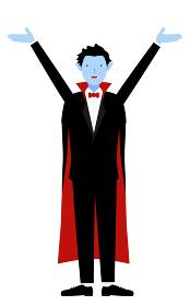ハロウィンの仮装、バンパイア姿の男性が両腕を上げるポーズ