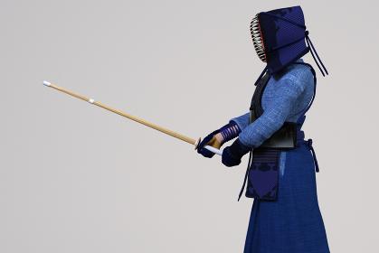 剣道の胴着をきて防具をつけた女の子が竹刀を握り試合をする