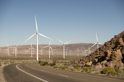 Highway winds past wind mills, bright sunny day, Anza Borrego desert