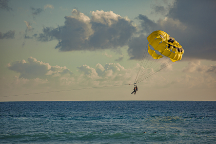 Paraglider in the sea at sunset 2