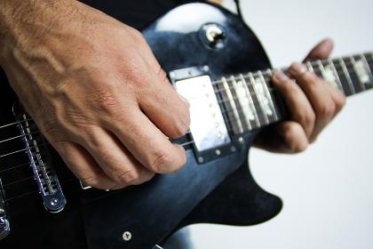 Man playing Gibson Les Paul Studio T ebony guitar close up fingers