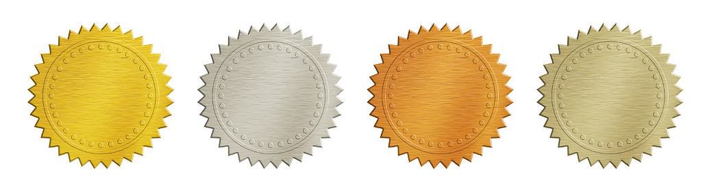 Gold and silver brushed metal badges over white