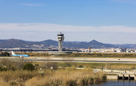 Landing strip at Barcelona airport with planes on the runway