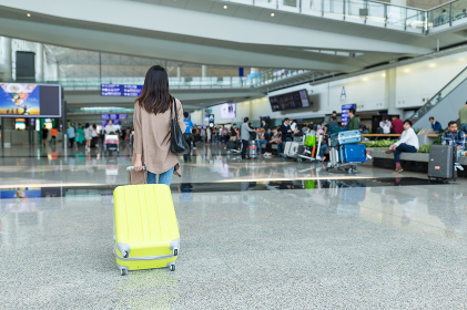 Back rear view of woman in Hong Kong airport