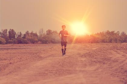 Man running outdoor sport free run at sunset
