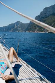 Woman sunbathing on Sailing Boat
