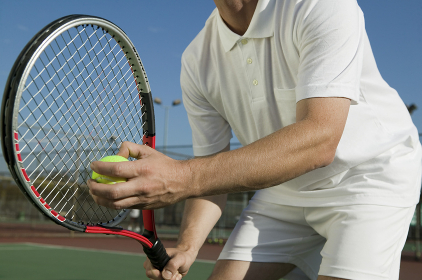 Male Tennis Player Preparing to Serve mid section low angle view