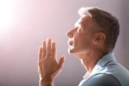 Close-up Of A Praying Mature Man