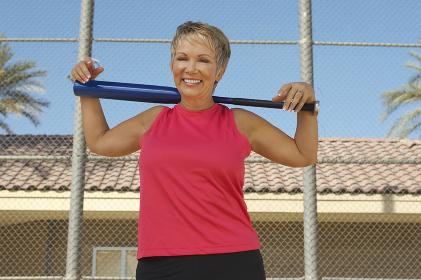 Woman Holding Baseball Bat On Shoulder