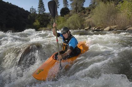 Caucasian Man Kayaking