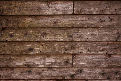 傷のある茶色い木目の背景画像