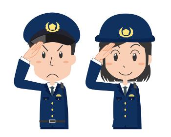 敬礼をする男女の警察官