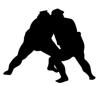 組み合う相撲のシルエット