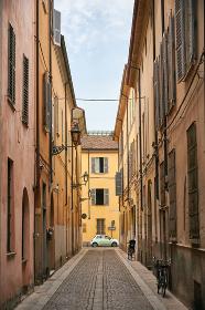 Auto on empty road in Italian town