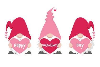 ハート型のメッセージボードを持った三人の北欧の小人、バレンタインデー