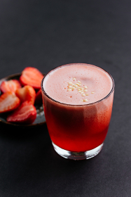 red strawberry alcoholic cocktail on a black background