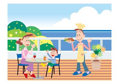 海辺で家族に料理を振る舞う父親