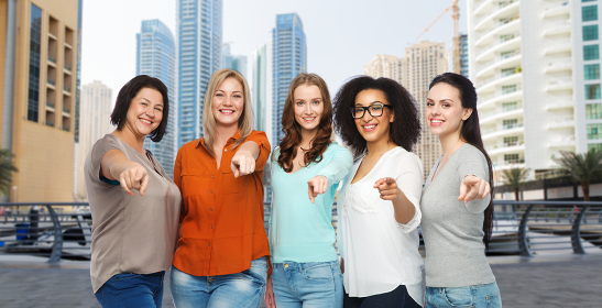 happy women pointing finger on you in dubai city