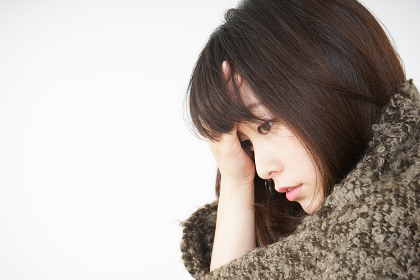 風邪で発熱した若い女性