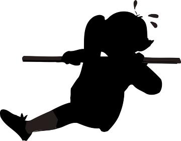 鉄棒の足かけあがりをしている人のシルエット