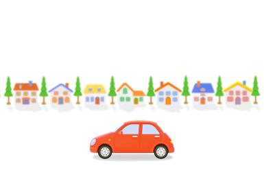 赤い車と家並み