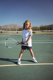 Portrait of girl playing tennis